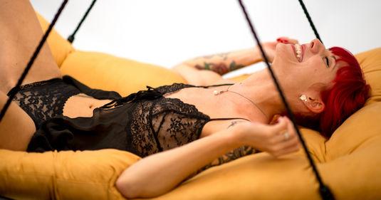 Girl enjoys a luxury sex swing